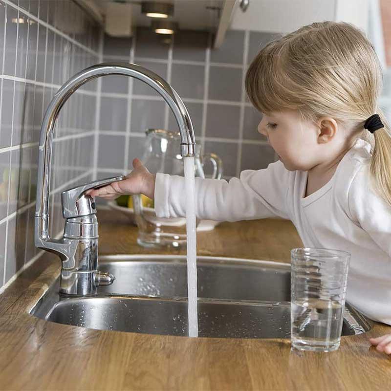 Girl at faucet